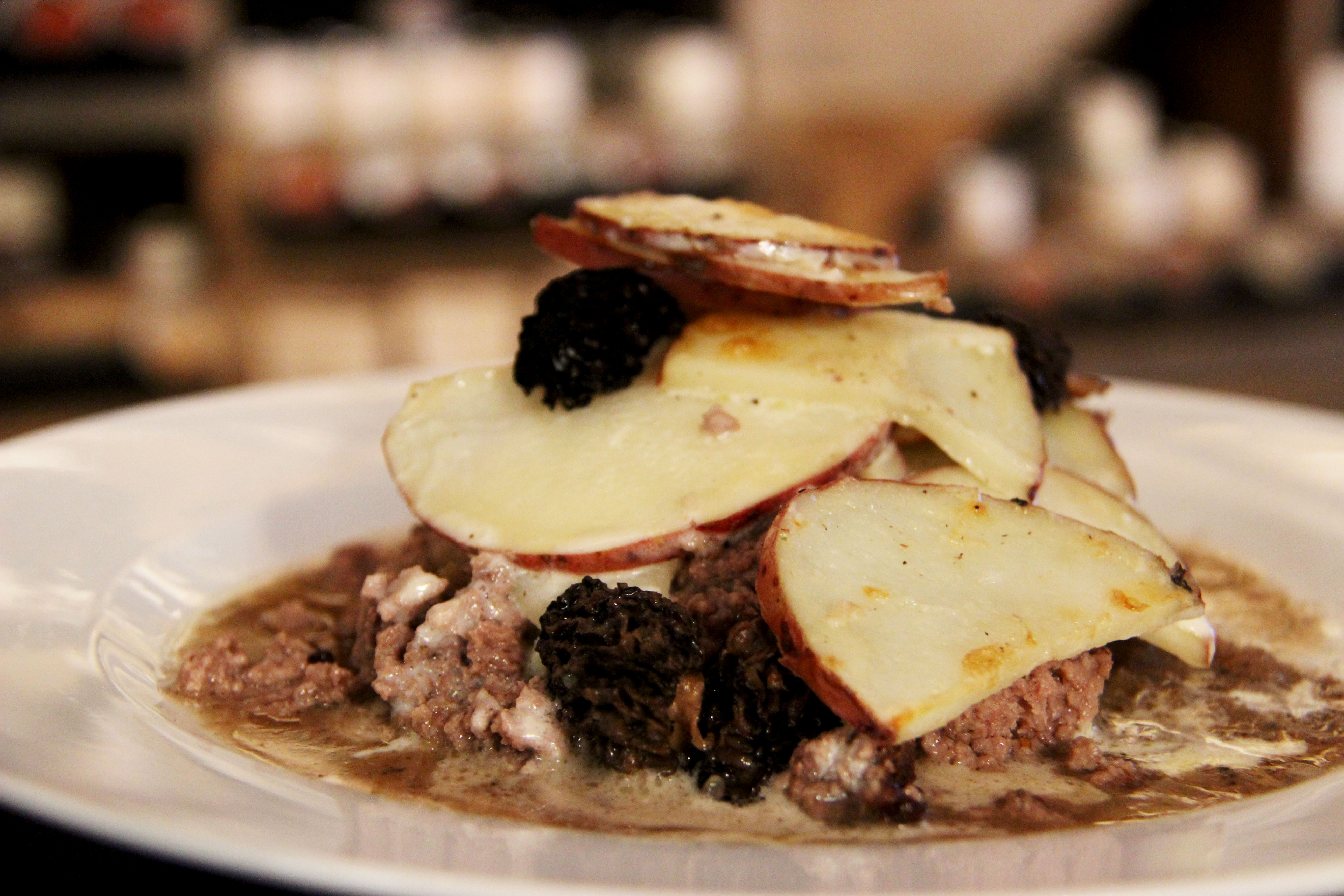 Decadant cottage pie, creamy scallop morels potatoes, beef, mushroom gravy and quebec trad