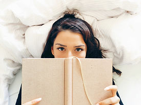 Girl Reading on Bed