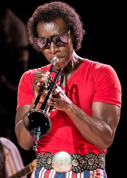 Done Cheadle as Miles Davis