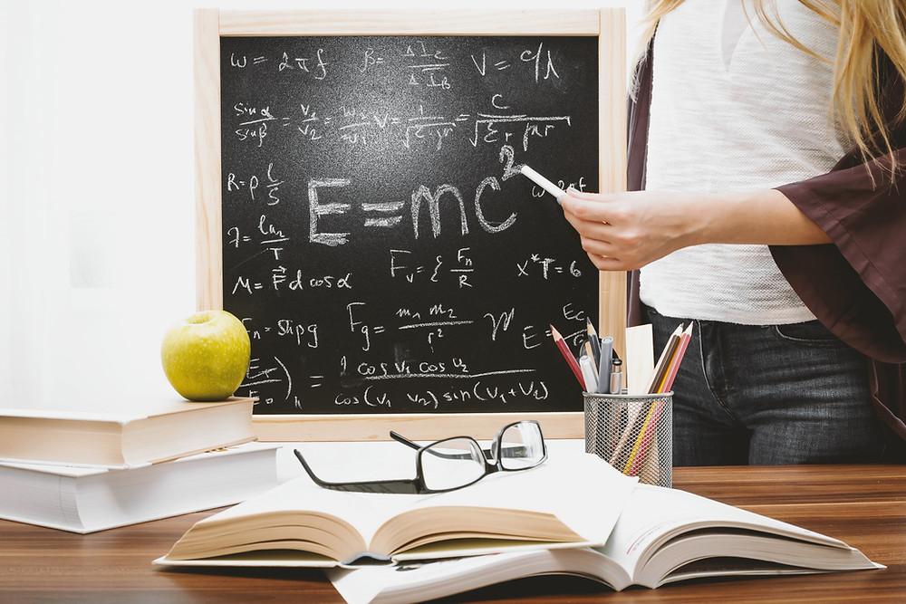 Teaching someone something using a chalkboard