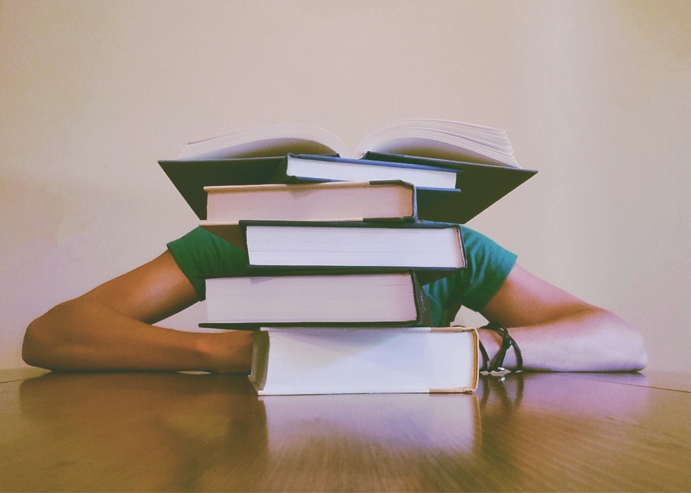 Stack of books in front of a person