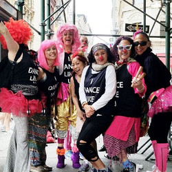 Clown Dancers, pink, red, and perky, and ready to Dance Like U in Dance Parade..