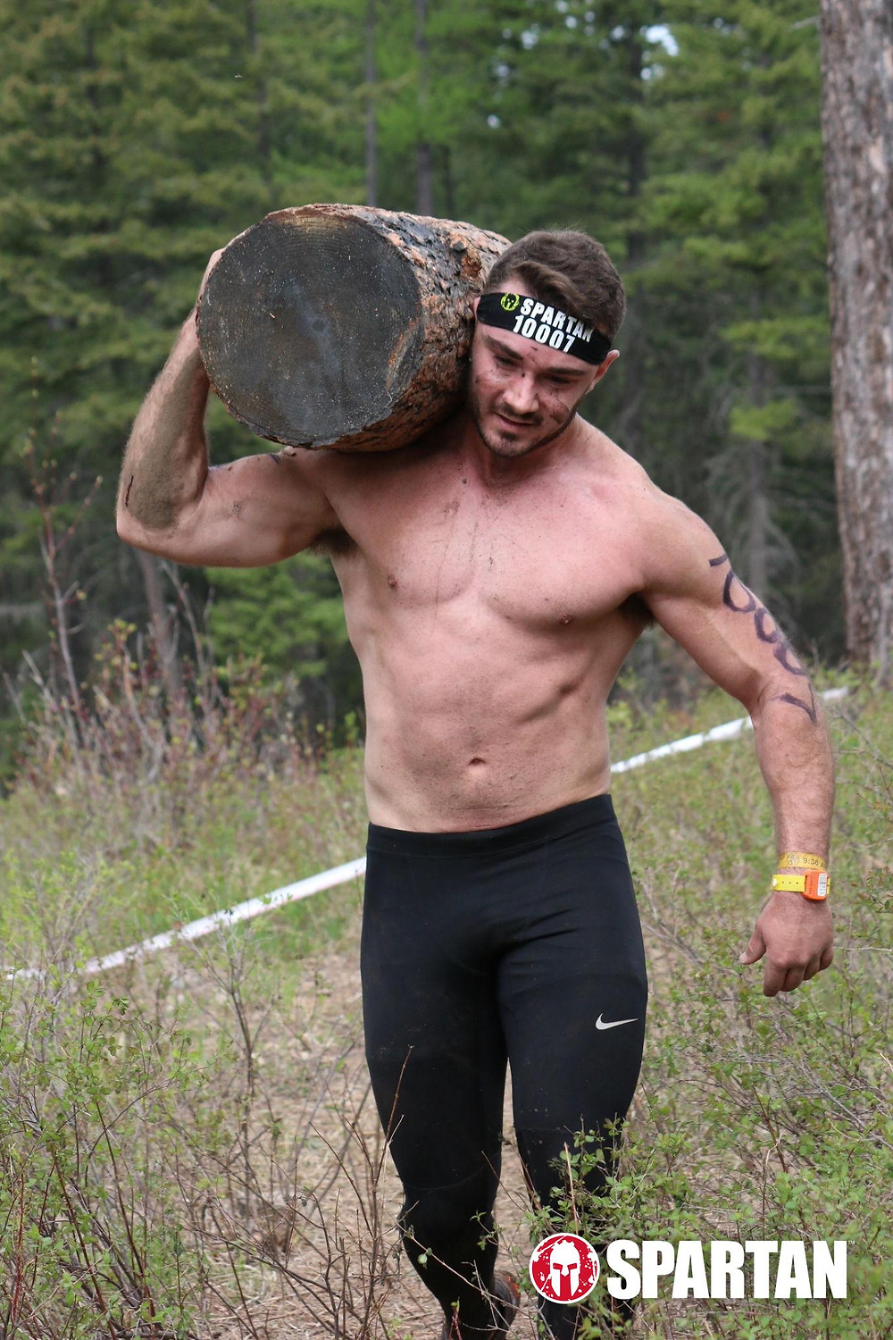 Bryce boepple carrying log during montana spartan race