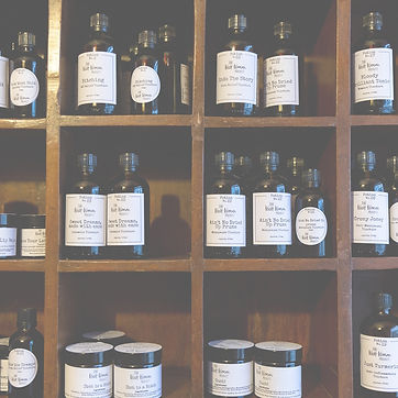 Image of a shelving unit full of black bottles with white labels