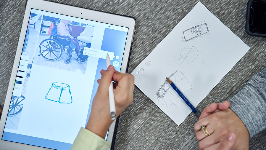 Image of a person drawing on an ipad