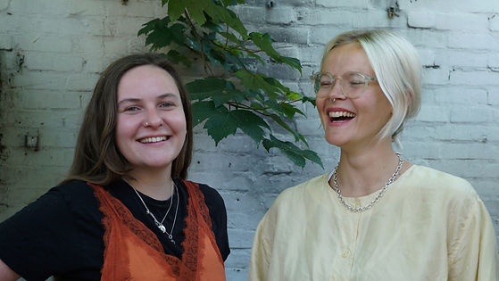 Image of two woman laughing together