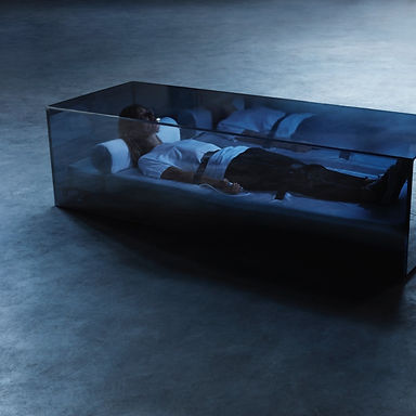 Image of a person lying in a see-through box