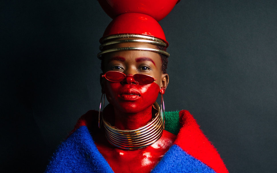 Image of a black women wearing red paint