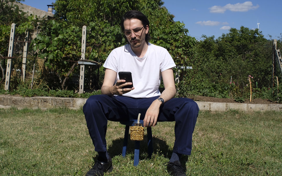 Image of a man sitting on a blue stool