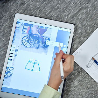 Image of person drawing on an ipad