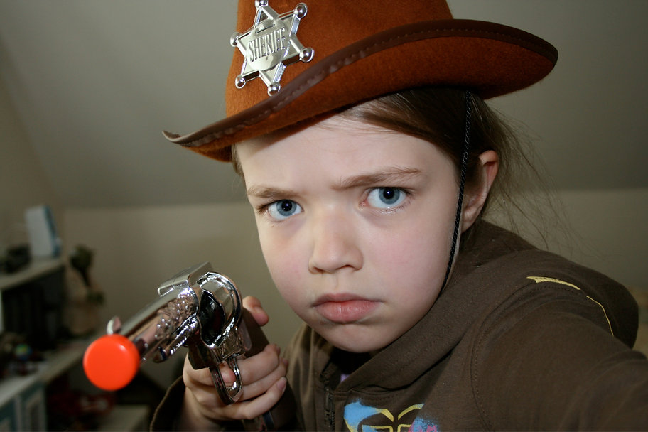 A young girl dressed as a cowboy