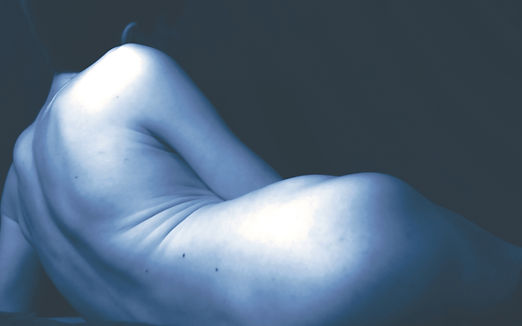 Image of a person laying on their side naked