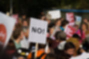 Protest with sign that reads NO