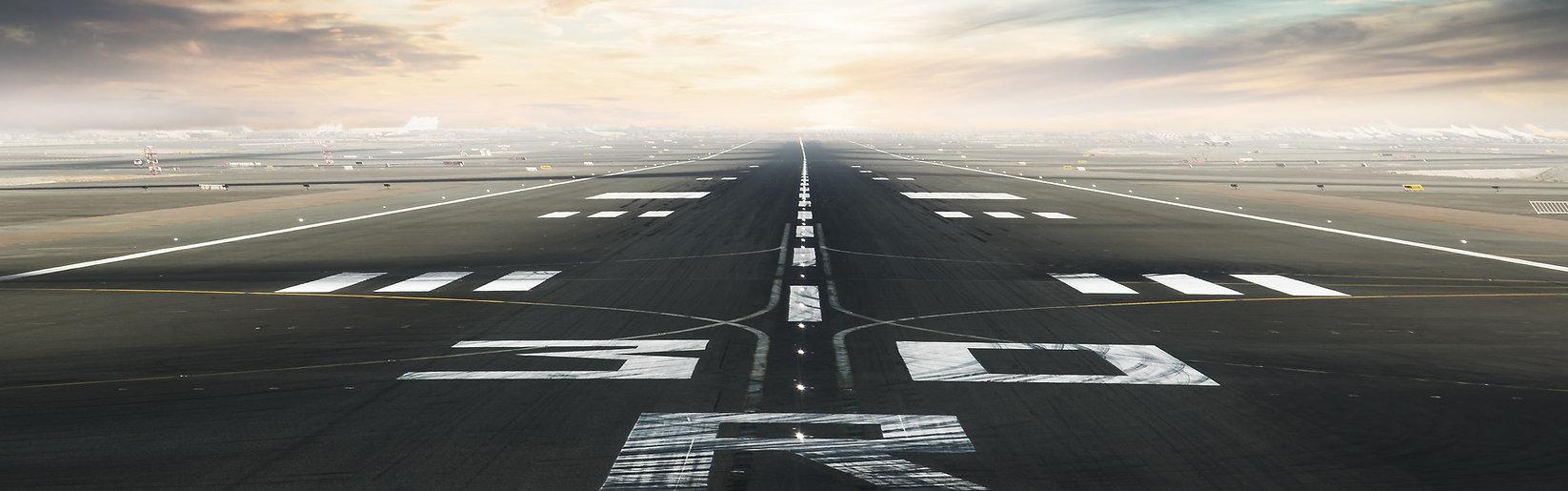 Empty asphalt airport runway with dramat