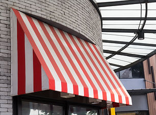 red and white striped awning  over the g
