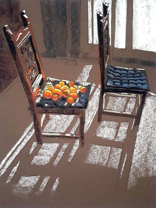 Oranges on the chair