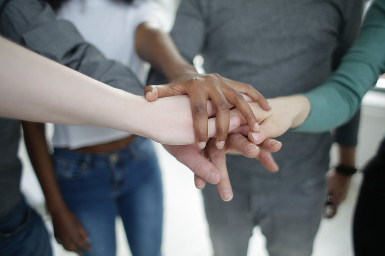 crop-diverse-colleagues-stacking-hands-t