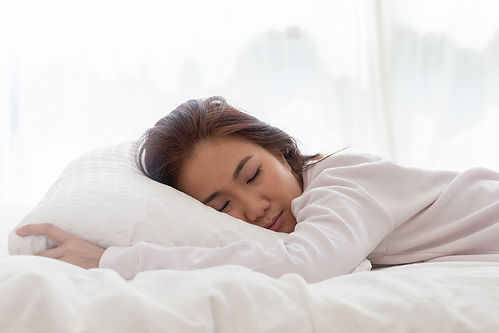 sleeping woman on a comfortable bed  shu