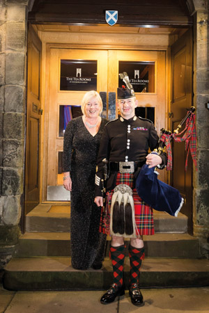 SJIB's Fiona Cornwall and the piper at the castle