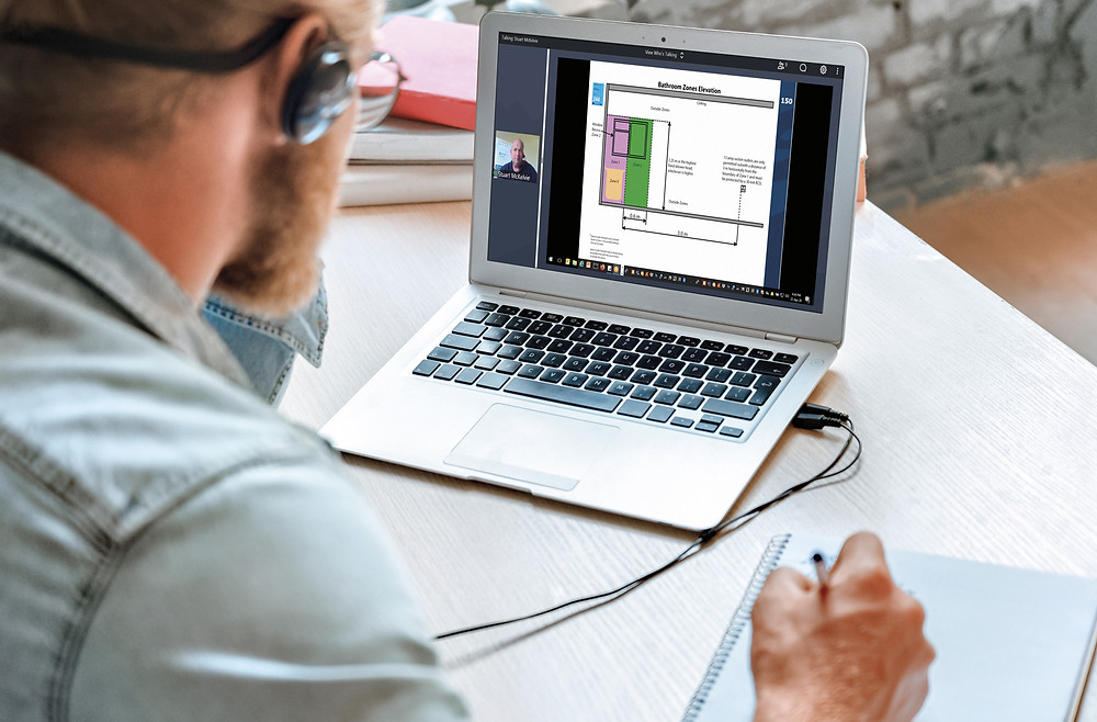 Man at laptop participating in an online training session