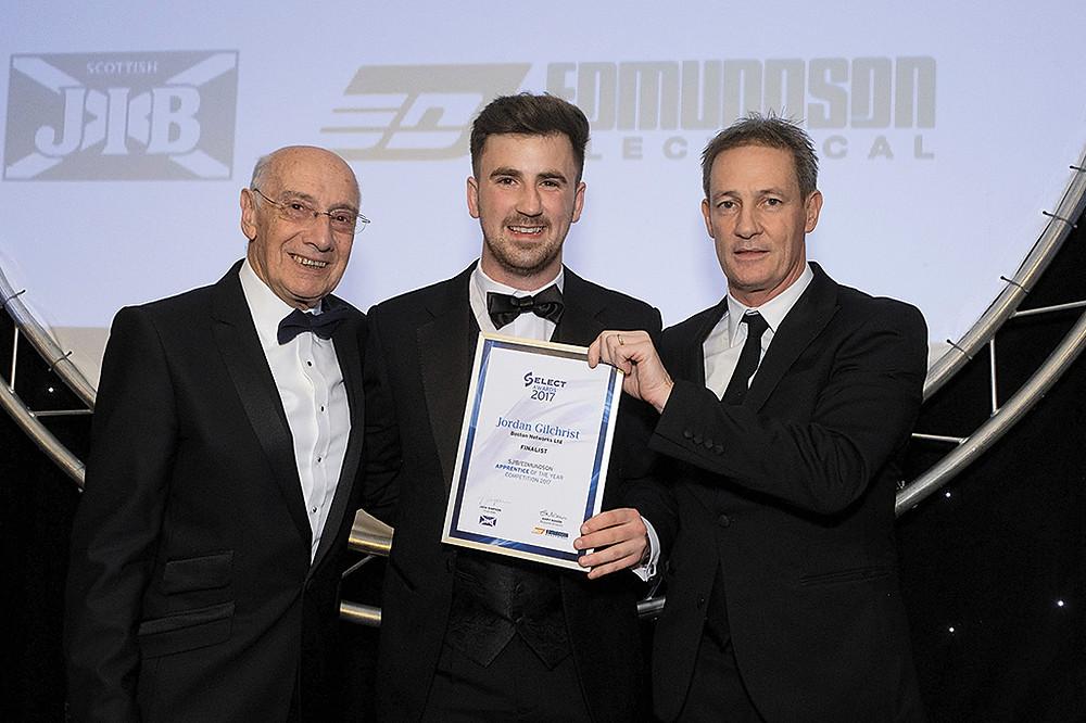 Jordan received his award from Jock Simpson, left, and Gary Mason from Edmundson