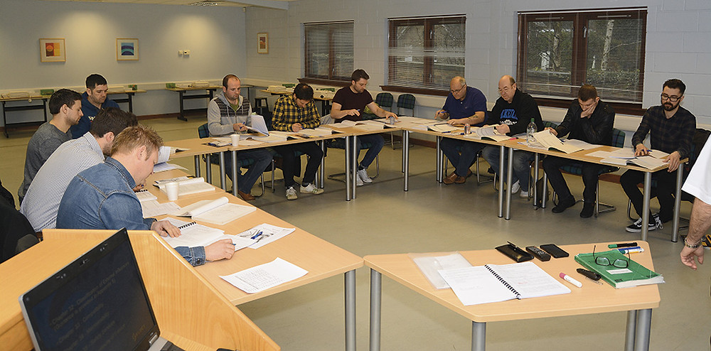 Members concentrate on a SELECT training course