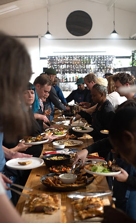 Harvest Table Guests Dishing Up.jpg