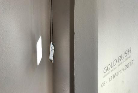 Pendant; gold, e-waste metal, aluminium, quartz crystal, reflective thread; 2017