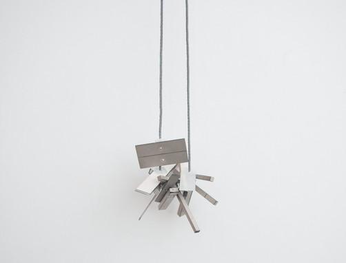 Pendant; silver, quartz crystal, reflective thread; 2017