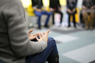 Person sitting in group