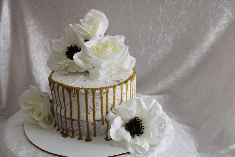 naked gold drip wedding cake