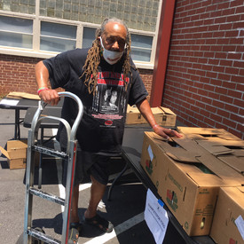 Alvin Dollar Assisting with Food Distribution
