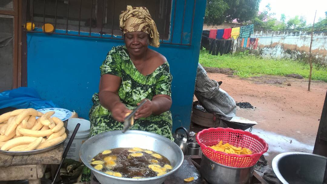 Founder preparing plantain chips.