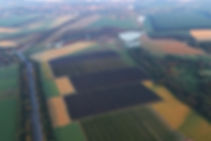 Green Farm Ukraine, airshot, apple orchard covered with hailnets.