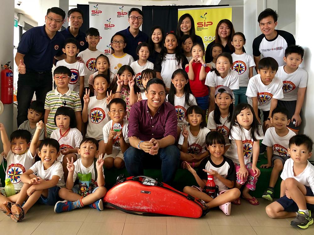 Joyful children with Adrian Anantawan