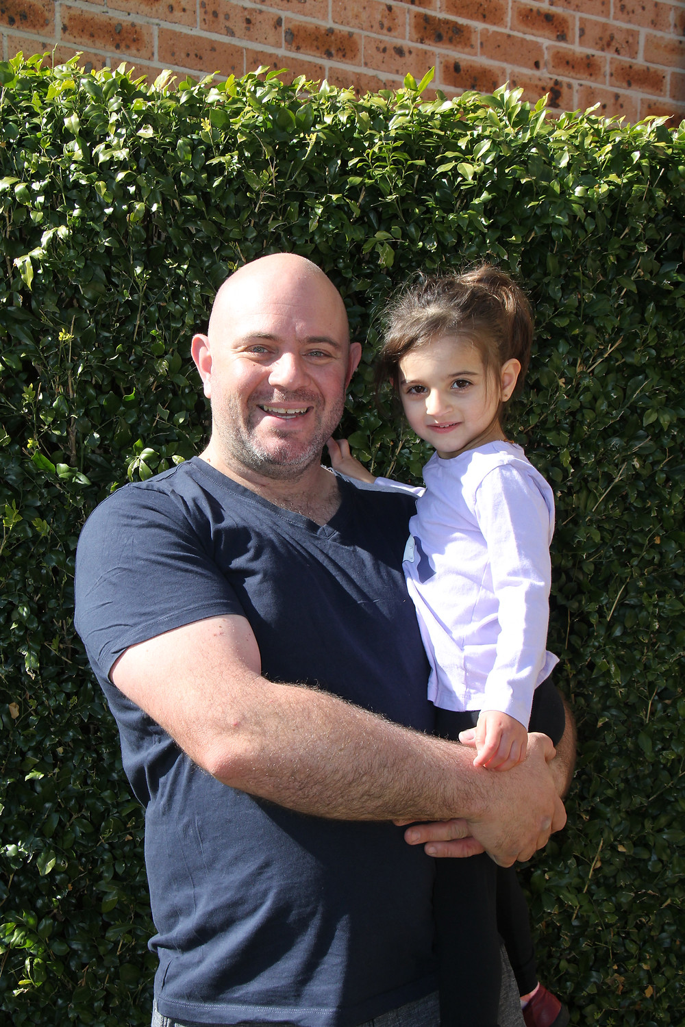Photo of Paul Gareffa, holding is two year-old daughter.