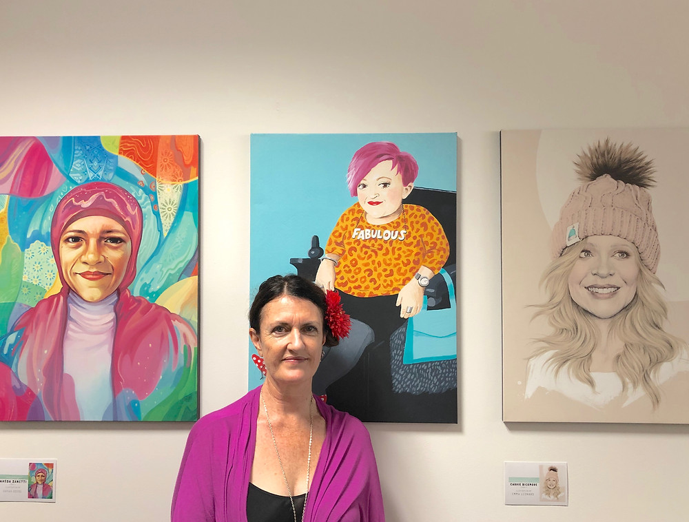 """Alannah Russack, pictured with some of the works included in the current Windsor Central Library exhibition, """"Shoutout to the Girls""""."""