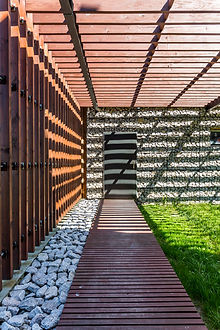 shady-wooden-path-to-stone-house-P9LFCRE