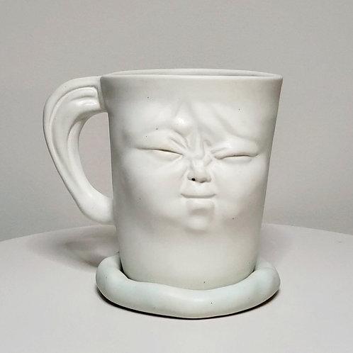(Left handed) Light-blue mug with a saucer