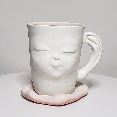 Pink mug with a saucer