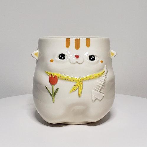 A cat with a yellow bandana