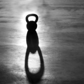 17058096-crossfit-kettlebell-weight-backlight-and-shadow-on-the-gym-floor.jpg