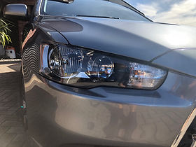 headlight restoration backed with a 12 month warranty