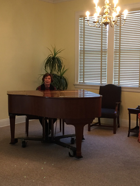 A baby grand piano adds elegance