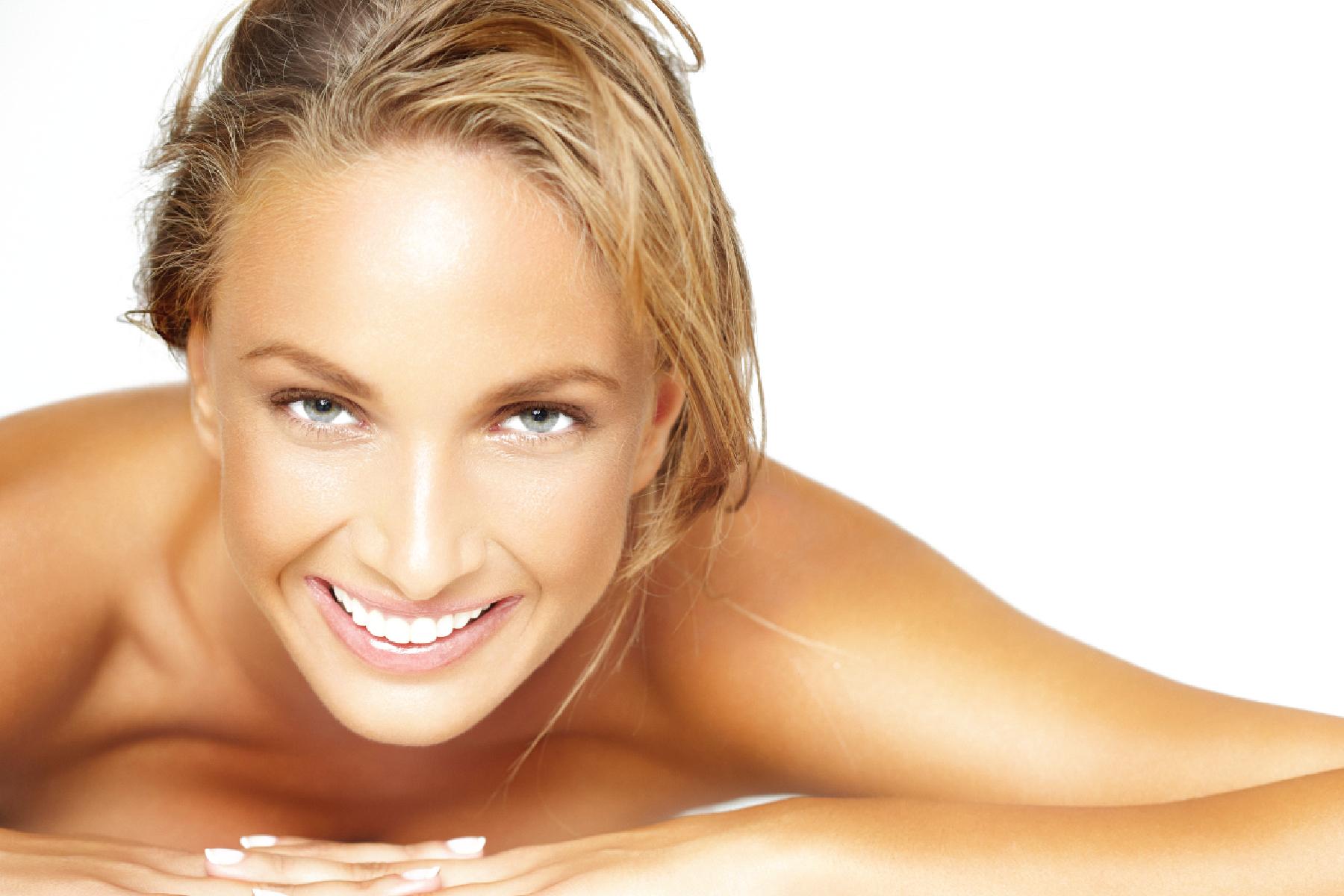 happy tanned blonde woman.jpg