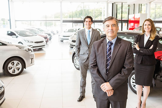Salespeople at a car dealership