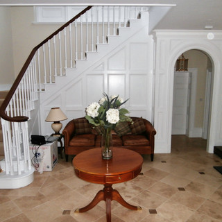 white painted staircase with walnut handrail
