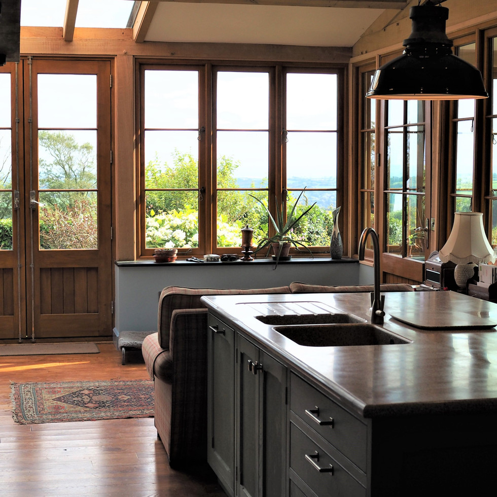 Green oak frame with large kitchen island