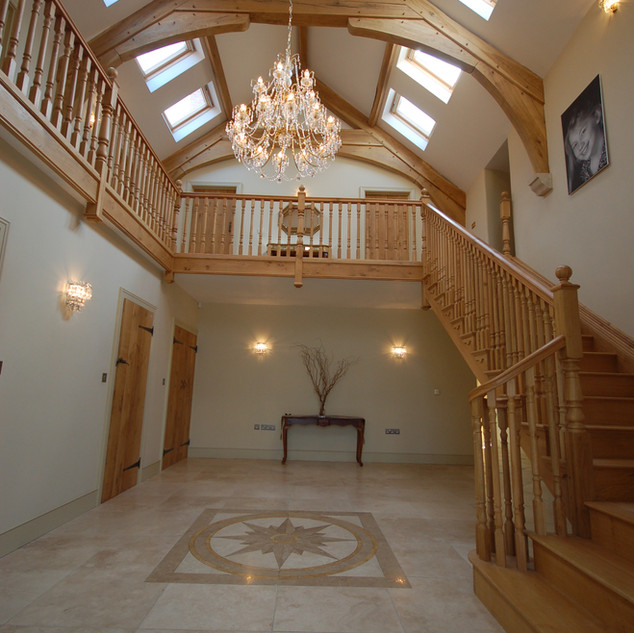 Oak framed building and grand staircase