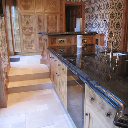 Glamorous burr oak and granite kitchen